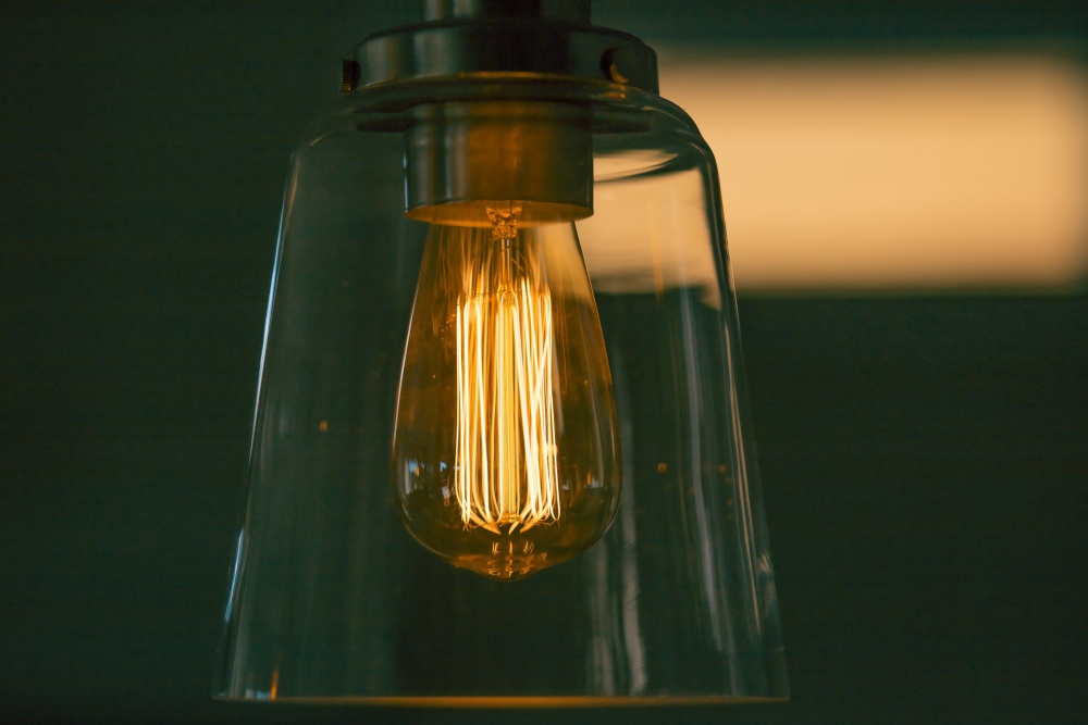 glowing lightbulb in glass case