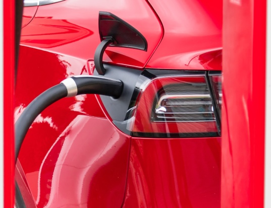 red electric car charging