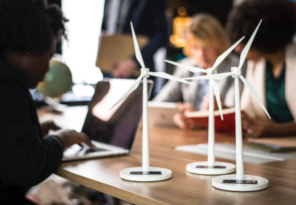 Wind turbines in a class room discussing sustainability