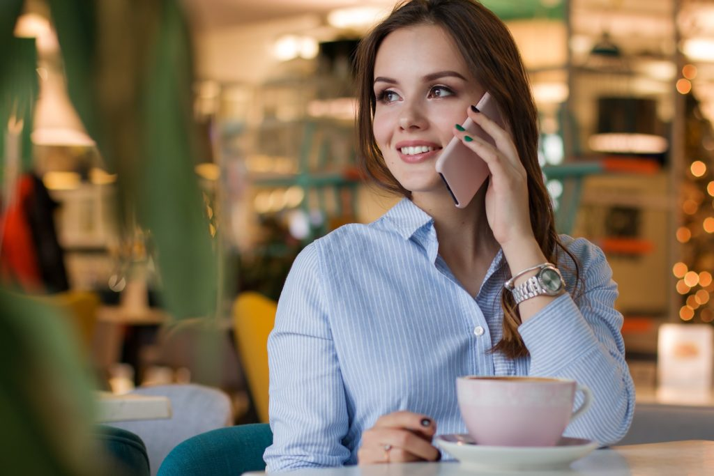 woman enjoying coffee and mobile phone